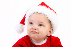 Baby wearing a christmas hat Royalty Free Stock Image