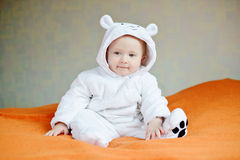 Baby wearing costume of polar bear Stock Photos