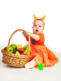 Baby wearing a costume of a squirrel. Studio portrait of a cute baby wearing a costume of a squirrel with a basket full of fruit stock photo