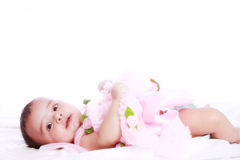 Baby wearing frock. Portrait of baby wearing pink frock , isolated against white backfround Stock Image
