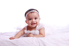 Baby wearing frock and smiling Royalty Free Stock Photo