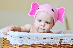 Baby wearing funny hat stock photography