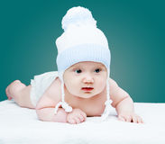 Baby wearing a hat stock image
