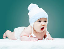Baby wearing a hat stock photos
