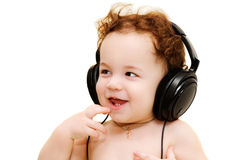 Baby wearing headphones Stock Photos