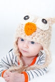 Baby Wearing Owl Costume Hat. Baby lying on his stomach in owl hat Royalty Free Stock Images