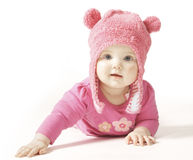 Baby wearing pink on white background. Cute baby wearing a pink hat with fluffy ears on a white background Royalty Free Stock Photos