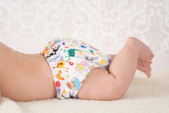 Baby wearing a reusable nappy Royalty Free Stock Images
