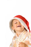 Baby wearing Santa Claus hat stock images