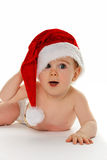 Baby wearing Santa hat. Cure smiling baby wearing Santa Claus hat, isolated on white background Stock Photo