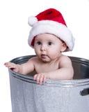 Baby Wearing Santa Hat in Wash Basin Stock Photos