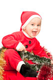 Baby wearing Santa suit Stock Photo
