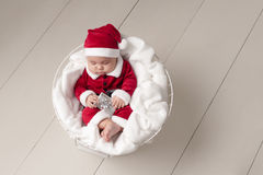 Baby Wearing a Santa Suit Stock Photos