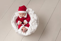 Baby Wearing a Santa Suit Stock Photo