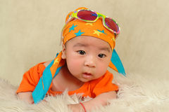 Baby wearing sunglasses and a turban. He looks very funny Royalty Free Stock Images