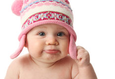 Baby wearing winter hat. Close up portrait of an adorable baby wearing a knit winter cap, isolated on white Royalty Free Stock Image