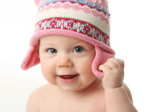 Baby wearing winter hat. Close up portrait of an adorable baby wearing a knit winter cap, isolated on white Royalty Free Stock Photos