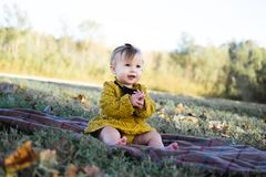Baby Wearing Yellow Crochet Long Sleeve Dress Sitting on Brown Textile Stock Photos