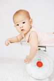 Baby on on weighing scale Stock Photos