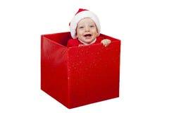 Baby-Weihnachtsgeschenk-Lächeln Lizenzfreie Stockfotos