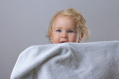 Baby wet bathroom. Clean white towel hiding jokes Royalty Free Stock Image