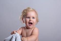 Baby wet bathroom. Clean white towel hiding jokes stock photos
