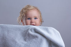 Baby wet bathroom. Clean white towel hiding jokes stock images
