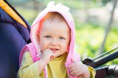 Baby in a wheelchair Stock Photos