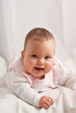 Baby on white. Smiling baby girl on white background Stock Photos