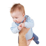 Baby on white background. Child on his father's arms Royalty Free Stock Photos