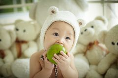 Baby with white bear hat Stock Images