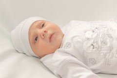 Baby in white a cap Royalty Free Stock Images