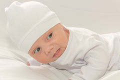 Baby in white a cap Stock Image
