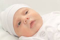 Baby in white a cap Royalty Free Stock Photography