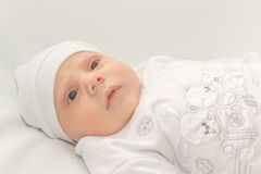 Baby in white a cap Stock Photos