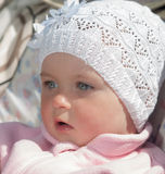 Baby in white cap. Portrait of baby in white cap closeup Royalty Free Stock Photo