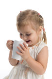 Baby with a white cup. Little girl holding a white mug Stock Photo