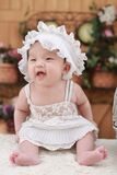Baby in White Dress With White Headdress Stock Photos
