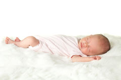 Baby on white fur Stock Photography