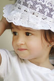 Baby with white hat Stock Image