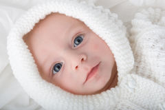 Baby in white hooded top Stock Photos