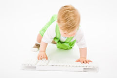 Baby with white keyboard Royalty Free Stock Photography