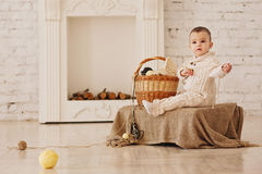Baby in white knit coverall Stock Photography