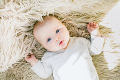 Baby in White Onesie Royalty Free Stock Image