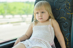 Baby in white ride bus Royalty Free Stock Images
