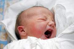 Baby in white swaddling clothes Stock Photos