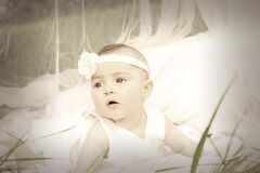 Baby in White Tank Dress and Headband Stock Photography