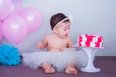 Baby in White Tutu Skirt Beside Cake Royalty Free Stock Image