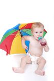 Baby in white with umbrella. A little cute baby isolated in white Royalty Free Stock Images