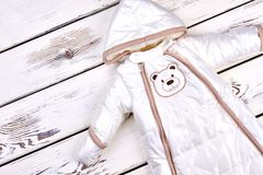 Baby white warm winter romper. Stock Image